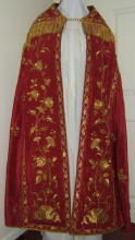 Red silk Gothic cope with rich gold bullion embroidery